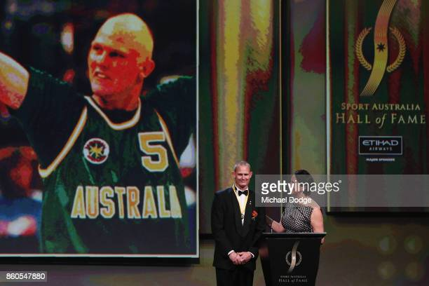 Sport Australia Hall of Fame Inductee and legend basketballer Troy Sachs peaks on stage at the Annual Induction and Awards Gala Dinner at Crown...