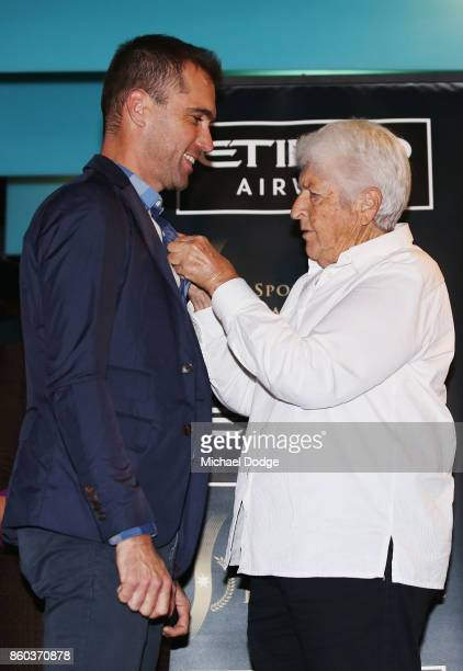 Sport Australia Hall of Fame Inductee and legend Cyclist Brad McGee gets his pin presented by sporting legend Dawn Fraser at the National Sport...