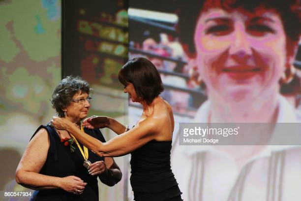Sport Australia Hall of Fame Inductee and sports medicine Dr Grace Bryant gets presented her medal by Annie Sargeant at the Annual Induction and...