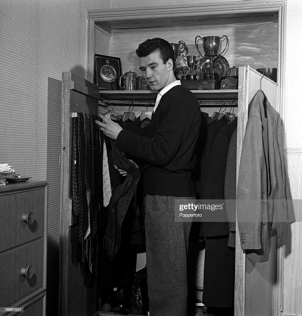 Sport, Boxing, England, 1957, British Champion Boxer Peter Waterman, the brother of actor Dennis Waterman, is pictured getting dressed in his bedroom