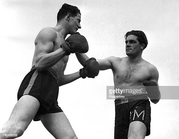 Sport Boxing England Sgt Freddie Mills of the RAF is pictured in training with a partner outdoors Freddie later became Light Heavyweight World Boxing...