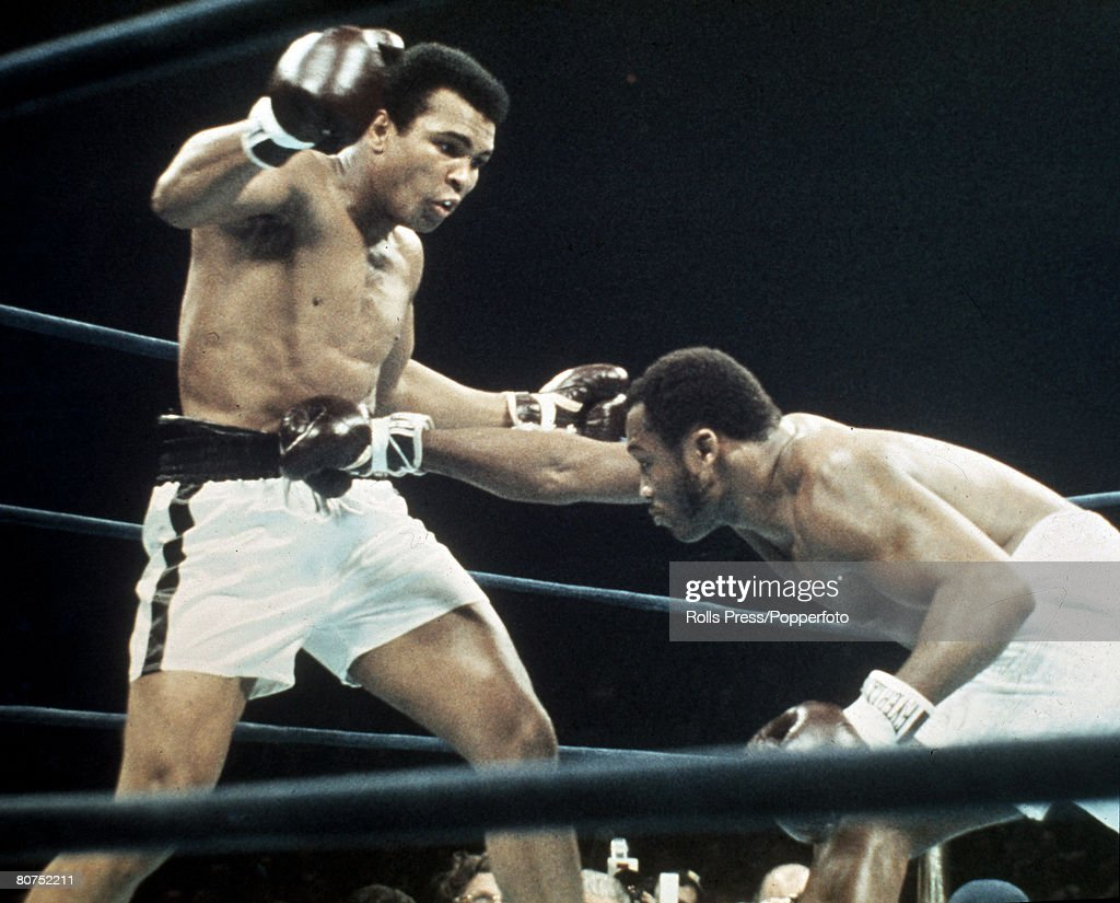 28th January 1974, Madison Square Garden New York, Heavyweight Fight, Joe Frazier lands a right to the midriff of <a gi-track='captionPersonalityLinkClicked' href=/galleries/search?phrase=Muhammad+Ali+-+Boxer+-+Born+1942&family=editorial&specificpeople=93853 ng-click='$event.stopPropagation()'>Muhammad Ali</a> although Ali came out of the fight the winner gaining a 12 rounds points decision
