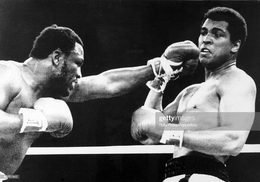 1st October 1975, World Heavyweight Championship, The 'Thrilla in Manila', First Round, Heavyweight Champion <a gi-track='captionPersonalityLinkClicked' href=/galleries/search?phrase=Muhammad+Ali+-+Boxer+-+Born+1942&family=editorial&specificpeople=93853 ng-click='$event.stopPropagation()'>Muhammad Ali</a>, right who beat challenger <a gi-track='captionPersonalityLinkClicked' href=/galleries/search?phrase=Joe+Frazier+-+Boxer&family=editorial&specificpeople=214108 ng-click='$event.stopPropagation()'>Joe Frazier</a> on a TKO, in the 14th round