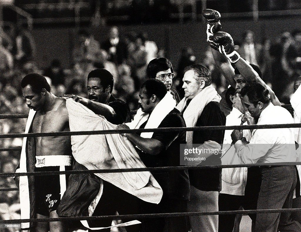 Sport, Boxing, Yankee Stadium, New York, USA, 28th September 1976, Heavyweight Championship of the World, Muhammad Ali raises his arms in celebration after retaining his Heavyweight title against fellow American Ken Norton (left) who looks downhearted, Muhammad Ali won after 15 rounds on a points decision