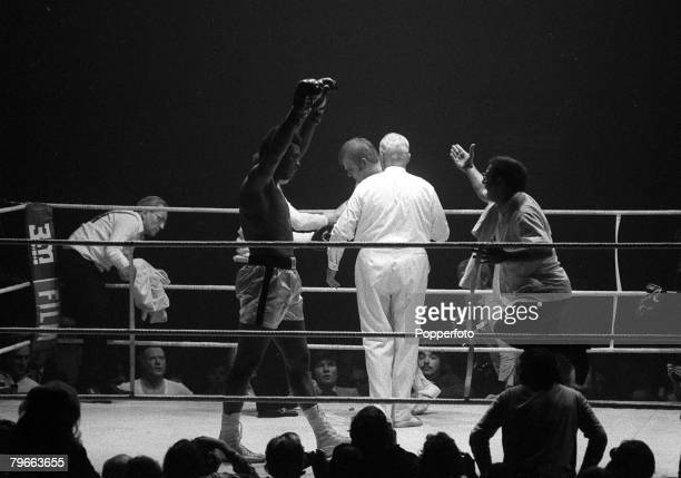 Sport Boxing Zurich Switzerland 26th December 1971 American boxer Muhammad Ali raises his arms in celebration as trainer Angelo Dundee rushes to...