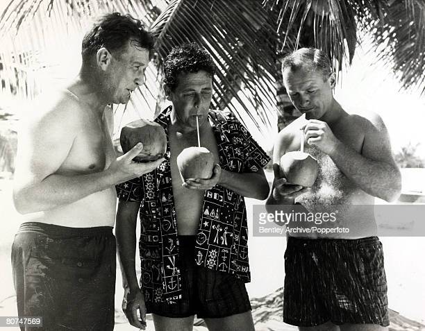 9th February 1965 Members of the Cavaliers cricket tour enjoying a drink on the beach at Montego Bay leftright Jim Laker tour captain Trevor Bailey...