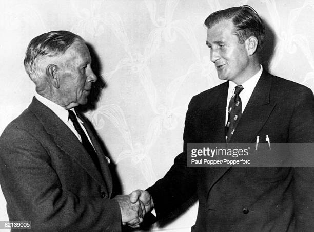 July 1956 Former Australia cricketer Arthur Mailey pictured with England slow bowler Jim Laker both men had in Test matches many years apart...