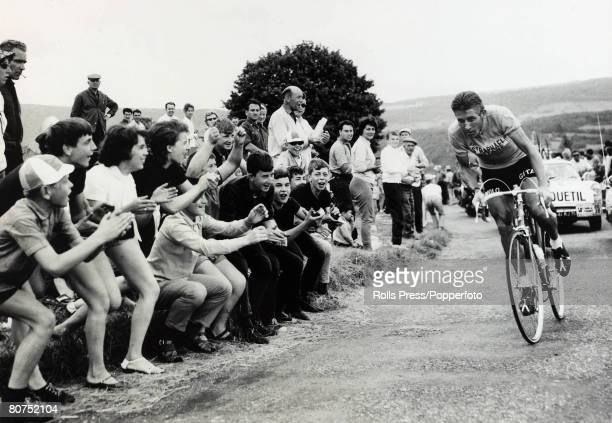 13th July 1963 French cahamion Jacques Anquetil wearing the race leader's yellow jersey roared on by an excited crowd near Besancon