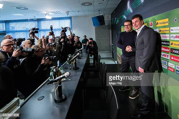 Sport Director Max Eberl of Moenchengladbach and Dieter Hecking the newly appointed head coach of Borussia Moenchengladbach shake hands prior a press...