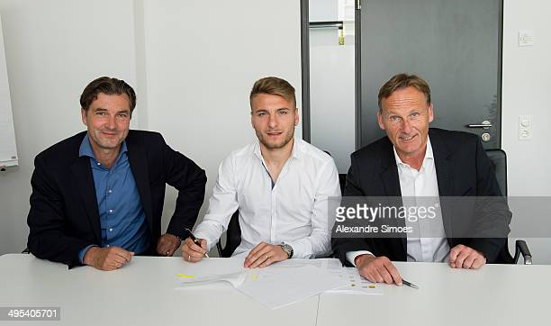 Sport director of Borussia Dormund Michael Zorc Ciro Immobile and CEO of Borussia Dortmund HansJoachim Watzke sign the new contract on June 2 2014 in...