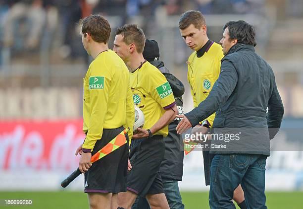 Sport director Samir Arabi of Bielefeld argues with referee Christian Bandurski after the Second Bundesliga match between Karslruher SC and Arminia...