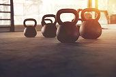 Sport equipment in gym. kettlebell on floor background and sunlight. Fitness training, copy sapce