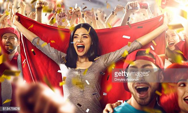 Sport fans: A girl holds a flag in her hands