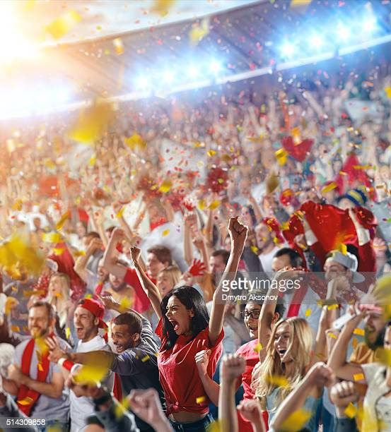 Sport fans: Girl puts hands in the air