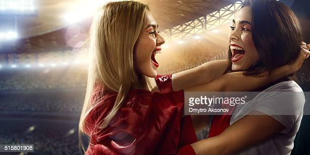Sport fans: Girls shouting and hugs each other