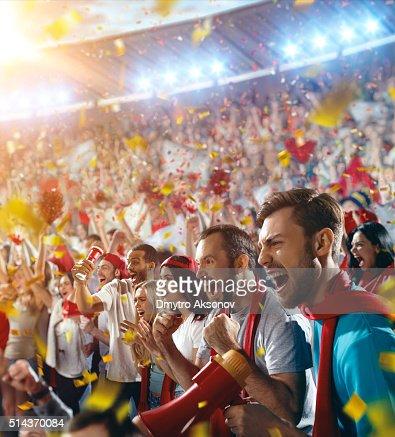Sport fans: Happy cheering crowd