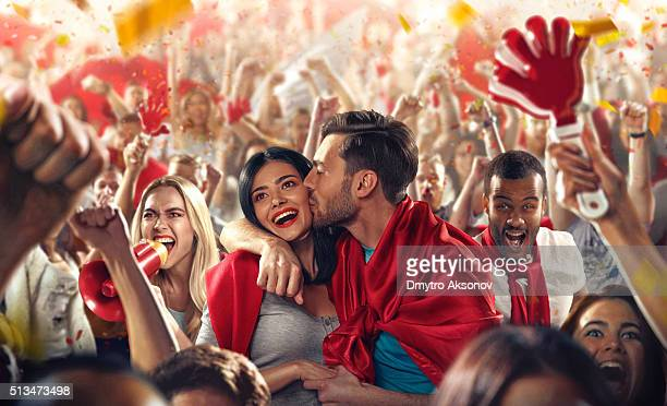 Sport fans: Man kisses woman