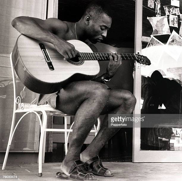 Sport Football 11th May 1970 Brazil star Pele relaxing playing the guitar at Brazil's training camp in Mexico Pele was perhaps the greatest player of...