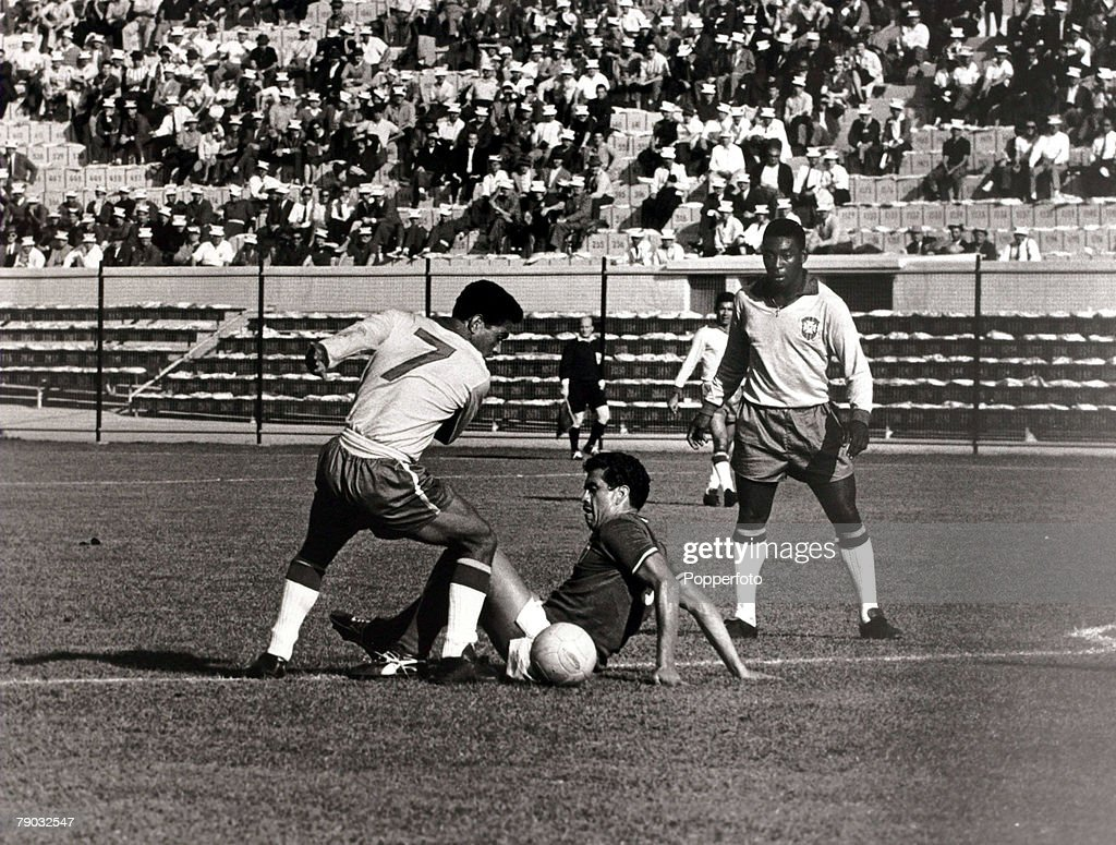 Sport, Football, 1962 World Cup Finals, Vina Del Mar, Chile, 30th May 1962, Group 3, Brazil 2 v Mexico 0, Brazil's <a gi-track='captionPersonalityLinkClicked' href=/galleries/search?phrase=Garrincha&family=editorial&specificpeople=939039 ng-click='$event.stopPropagation()'>Garrincha</a> (7), watched by Pele (right), leaves a Mexico defender on the floor