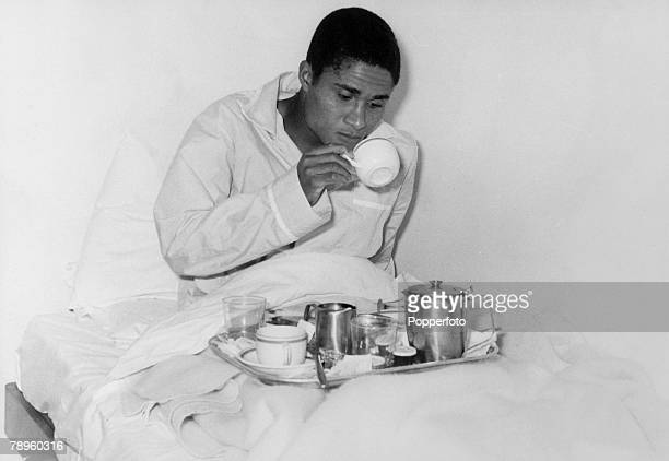 Sport Football 1966 World Cup Finals London pic 25th July 1966 Portugal's Eusebio takes breakfast in bed at the Saxon Inn Hotel in Harlow on the eve...
