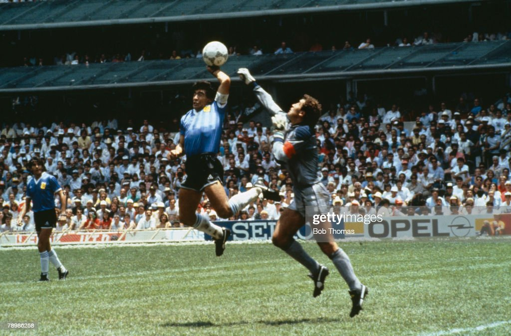 Sport, Football, 1986 Football World Cup, Mexico, Quarter Final, Argentina 2 v England 1, 22nd June, 1986, Argentina's <a gi-track='captionPersonalityLinkClicked' href=/galleries/search?phrase=Diego+Maradona&family=editorial&specificpeople=210535 ng-click='$event.stopPropagation()'>Diego Maradona</a> scores 1st goal with his Hand of God, past England goalkeeper <a gi-track='captionPersonalityLinkClicked' href=/galleries/search?phrase=Peter+Shilton&family=editorial&specificpeople=233478 ng-click='$event.stopPropagation()'>Peter Shilton</a>