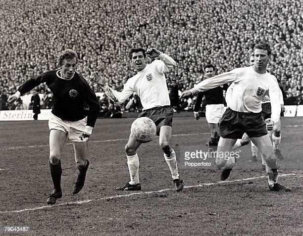 Sport Football 2nd April 1966 Home International Championship Hampden Park Glasgow Scotland 3 v England 4 Scotland's Denis Law gets past England...