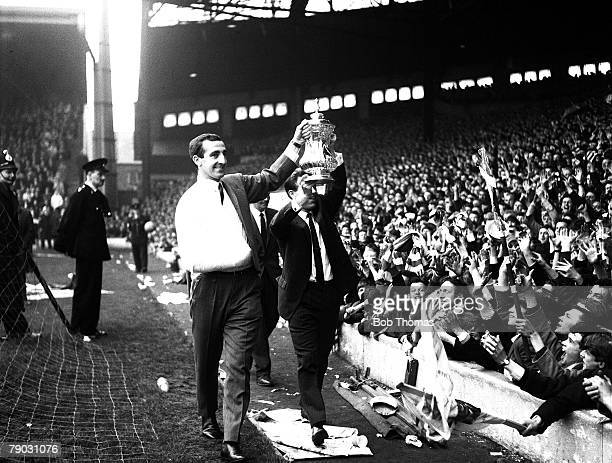 Sport Football Anfield England Liverpool FC's Gerry Byrne and Gordon Milne show the FA Cup trophy to the 'Kop' Byrne broke his collarbone during the...