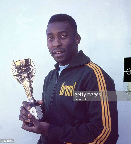Sport Football Brazil's Pele one of the stars of the victorious Brazil team of the 1970 World Cup Finals in Mexico holds the Jules Rimet trophy