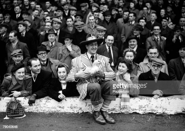 Sport Football England Blackpool supporters at a game against Newcastle with a colourfully dressed supporter carrying a duck which is the team's...