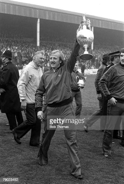 Sport Football England Nottingham Forest defender Kenny Burns proudly holds the First Division Championship trophy aloft as the team enjoy a lap of...