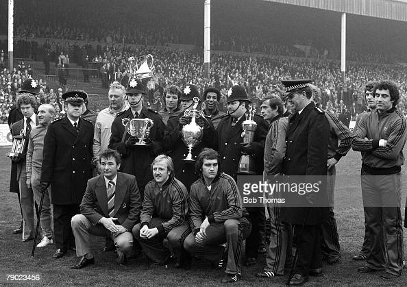Sport Football England The First Division Champions and League Cup winners Nottingham Forest line up with their trophies together with members of the...