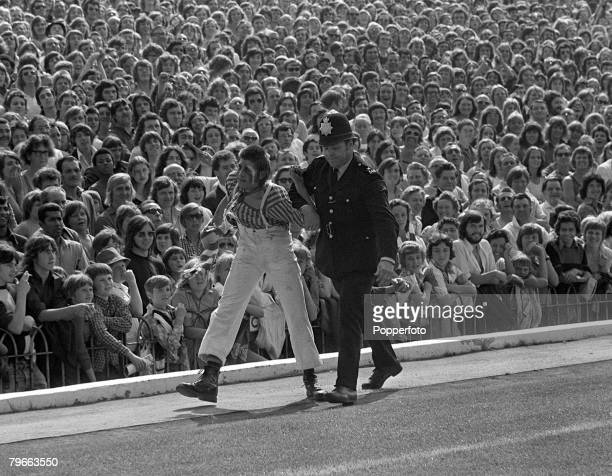 Sport Football English League Division One London England 25th August 1973 Arsenal v Manchester United A policemen ejects a 'fan' watched by a large...