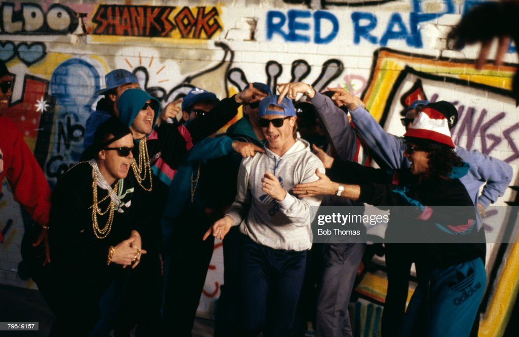 23rd April 1988, Liverpool team recording the video for their video 'The Anfield Rap', Steve McMahon centre, with players clowning around him