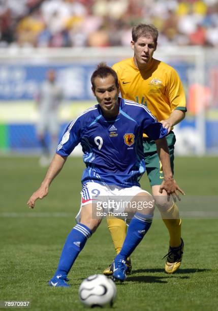 Sport Football FIFA World Cup Kaiserslautern 12th June 2006 Australia 3 v Japan 1 Japan's Naohiro Takahara closely watched by Australia's Scott...