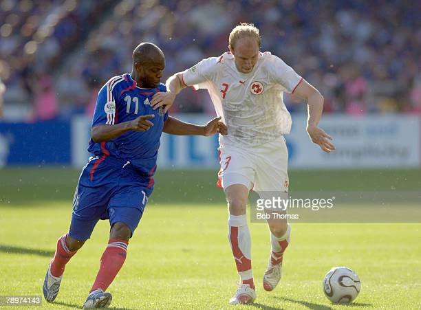 Sport Football FIFA World Cup Stuttgart 13th June 2006 France 0 v Switzerland 0 Switzerland's Ludovic Magnin challenged for the ball by France's...