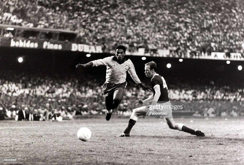 Sport, Football, Friendly International, Rio de Janeiro, 12th May 1962, Brazil 3 v Wales 1, Brazil star <a gi-track='captionPersonalityLinkClicked' href=/galleries/search?phrase=Garrincha&family=editorial&specificpeople=939039 ng-click='$event.stopPropagation()'>Garrincha</a> skips past Wales defender Terry Hennessey on an attacking run