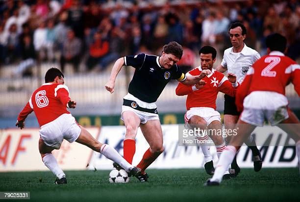 Sport Football Friendly International Valetta 22nd March 1988 Malta 1 v Scotland 1 Scotland's Roy Aitken takes on the Malta defence