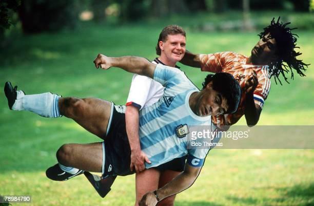circa 1990 Tottenham Hotspur and England star Paul Gascoigne having fun with giant cutout cards of international football stars Diego Maradona...