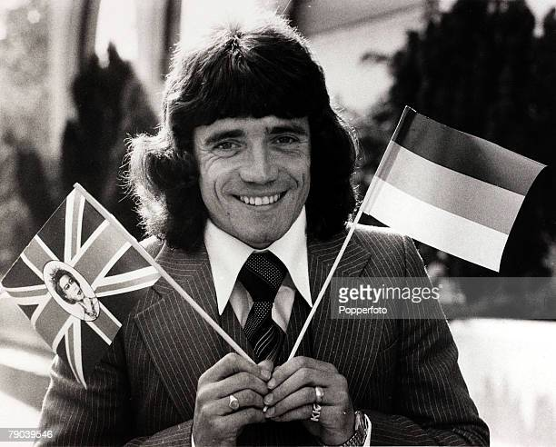 Sport Football June 1977 Liverpool's Kevin Keegan centre pictured on the day he signed for the German club SVHamburg waves the flags at a Liverpool...