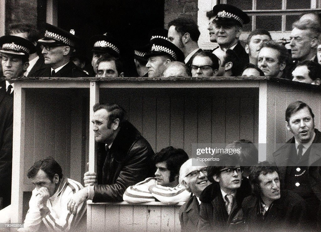Sport, Football, League Division One, Baseball Ground, England, 1st April 1972, Derby County v Leeds United, Leeds United Manager Don Revie (in winter coat) leans out from the dug-out as he watches the play