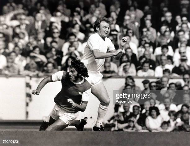 Sport Football League Division One Highbury London England 11th September 1971 Arsenal v Leeds United Arsenal's Peter Storey slides in to stop Leeds...