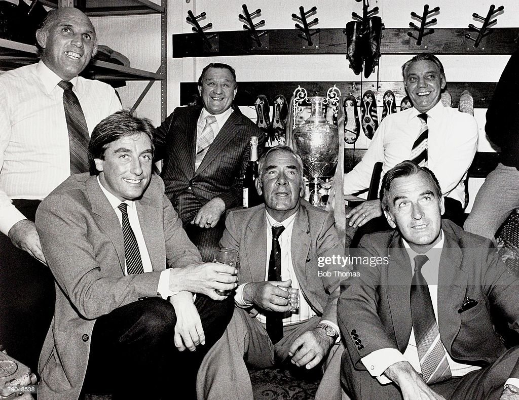 Sport, Football, Liverpool v Spurs, May 1982, Liverpool won the League, A picture of Liverpool's coaching staff enjoying a celebratory drink in the famous Anfield boot room, (Left-right): Ronnie Moran (1934-2017), Roy Evans, Bob Paisley (Manager), Tom Saunders, John Bennison and Joe Fagan