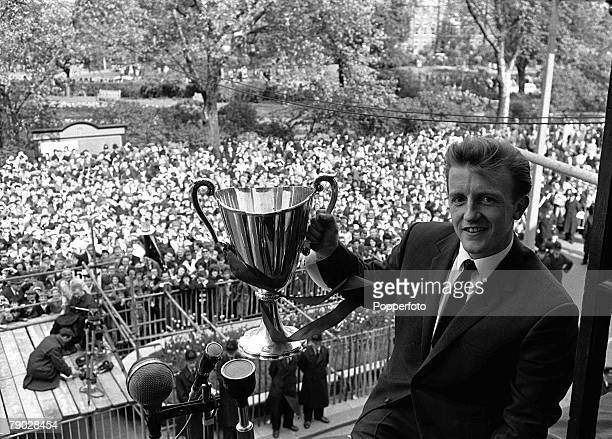 Sport Football London England 19th May 1963 Tottenham Hotspur's Terry Dyson shows the European CupWinners Cup to Spurs fans from the balcony of...