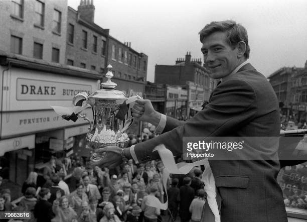 Sport Football London England 21st May 1967 Tottenham Hotspur goalkeeper Pat Jennings displays the FA Cup trophy to jubilant fans from an open top...