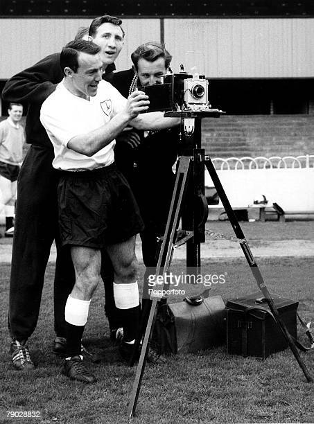 Sport Football London England 27th April 1962 Tottenham Hotspur's Jimmy Greaves 'takes over' a camera watched by Bill Brown during a photocall at...