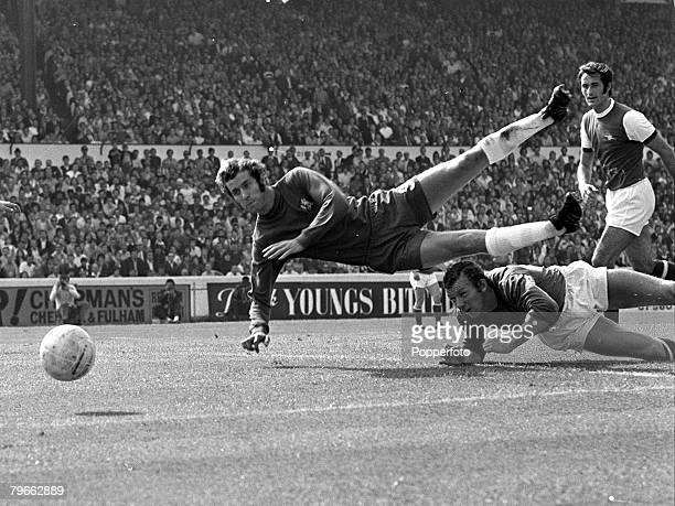 Sport Football London England 29th August 1970 League Division One Chelsea v Arsenal Chelsea's Peter Osgood tumbles over a challenge from Arsenal...