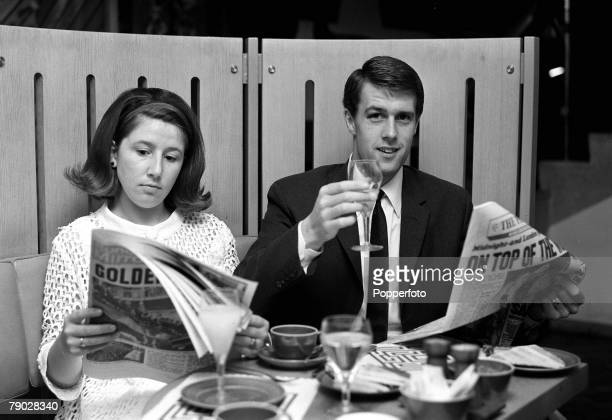 Sport Football London England 31st July 1966 England's World Cup hattrick hero Geoff Hurst and wife Judith are pictured reading the newspapers at a...