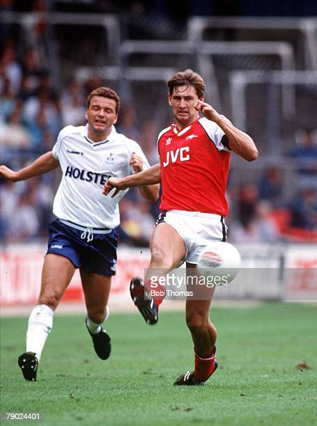 Sport Football London England The Wembley Tournament 13th August 1988 Arsenal 4 v Tottenham Hotspur 0 Arsenal's Tony Adams beats Tottenham's Paul...