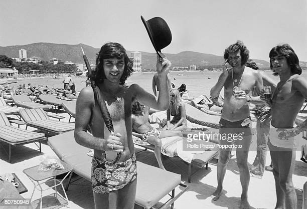 Sport Football Majorca Spain Manchester United player George Best on holiday Seen here with friends relaxing in the sun and carrying a black bowler...