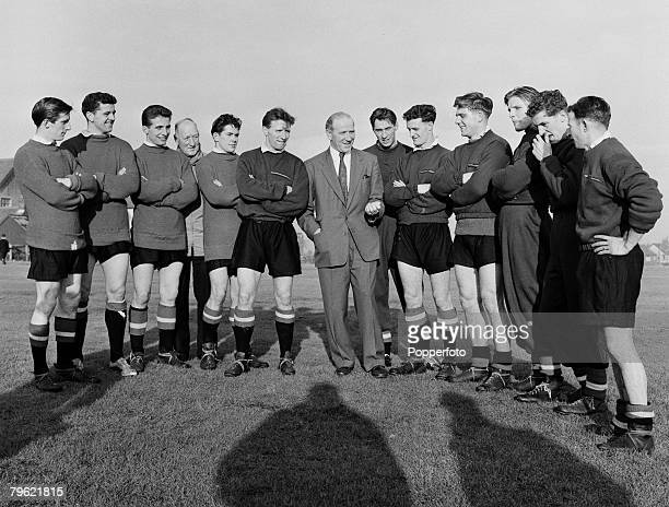 Sport Football Manchester England Manchester United manager Matt Busby with some of his players at a training session players include Dennis Viollet...